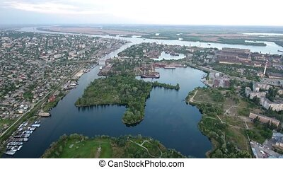 Aerial shot of the Dnipro river and its hydropark in Kherson...