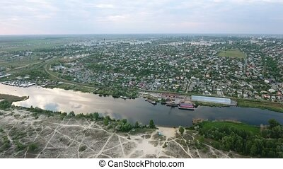 Aerial shot of the Dnipro river and Kherson city quay ina sunny day in summer