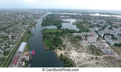 Aerial shot of the Dnipro river and Kherson city quaya in a...