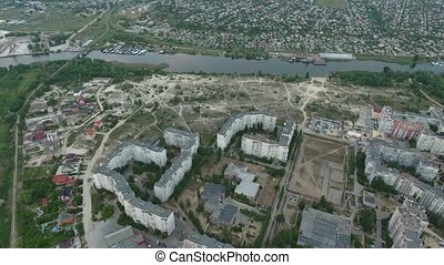 Aerial shot of the Dnipro river and Kherson city embankment in summer