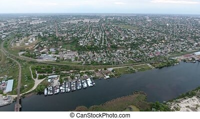 Aerial shot of the Dnipro river and Kherson city suburbs in...