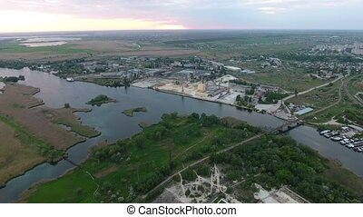 Aerial shot of the Dnipro river and Kherson suburbs with greenary in summer