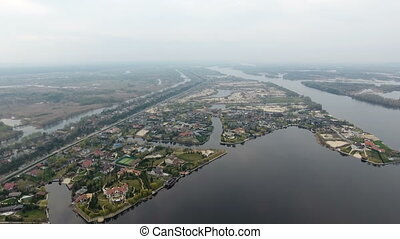 Aerial shot of the Dnipro river coastline with numerous summer cottages on it