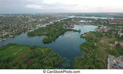 Aerial shot of the Dnipro river, Kherson city and hydropark in a sunny day in summer