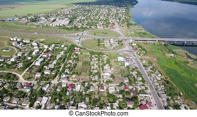 Aerial shot of the Dnipro river embankment in Kherson and a...
