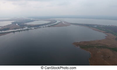 Aerial shot of the Dnipro river coastline with little islets, inflows and lakes