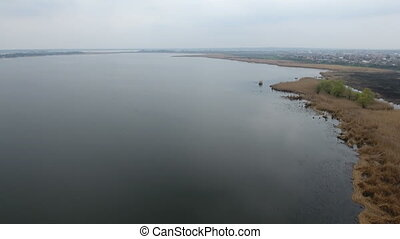 Astonishing aerial shot of the Dnipro river in all its beauty and greatness. The indented coastline covered with wild greenary and sand in Eastern Europe in a sunny day in spring