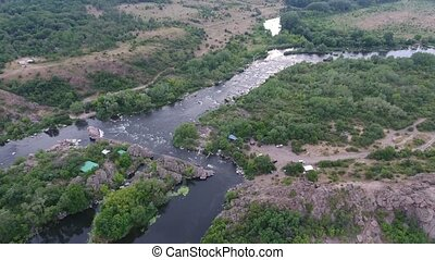 Aerial shot of the Dnipro river with inflows, rocks, wetland...