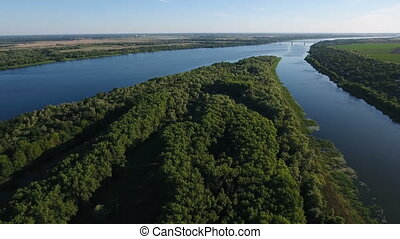 Aerial shot of the Dnipro river with its natural greenary and dark blue waters
