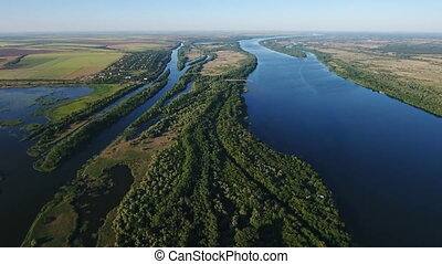 Aerial shot of the Dnipro river with its wild greenary and sparkling blue waters