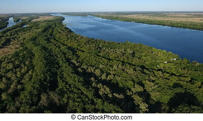 Aerial shot of the Dnipro river with wild greenary and...