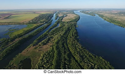 Aerial shot of the Dnipro with its curvy banks, inflows,...