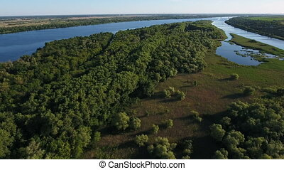 Aerial shot of the Dnipro with its nice inflows, greenary, islets, in summer