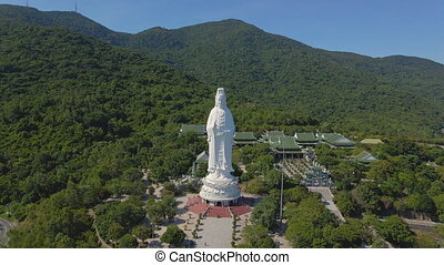 Aerial shot of the famous travel destination Son Tra Linh Ung Pagoda also known as Ledy Buddha in the city of Da Nang in central Vietnam. Travel to Vietnam concept. The City of Da Nang is the new Covid-19 hotspot in Vietnam.