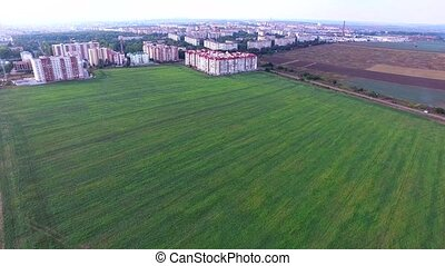 aerial shot of the field, and several buildings