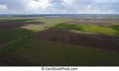 Aerial shot of the fields near the Dnipro river with splendid skyscape in spring