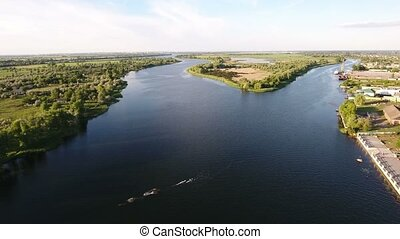 Aerial shot of the picturesque Dnipro river inflows, a nice islet in a sunny day