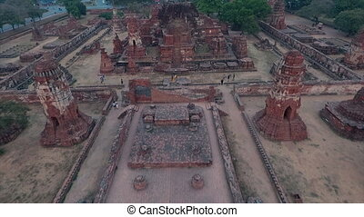 An aerial shot of the remains of an old temple of buddha in Sukhothai