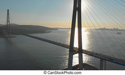 Aerial shot of the Russkiy cable bridge during sunset in a city of Vladivostok, Russia