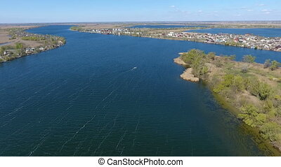 Aerial shot of the sparkling blue waters of the Dnipro with two river banks