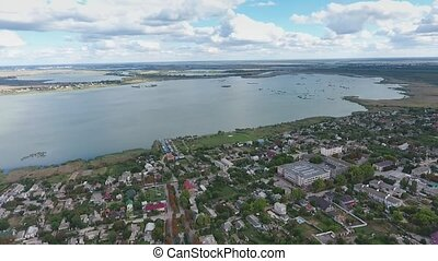 Aerial shot of the summer cottages on the Dnipro bank with...