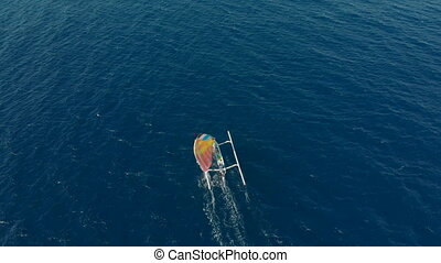 Aerial shot of the traditional fishing sailing boats in an open sea close to Bali island