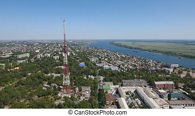 Aerial shot of the TV tower on the Dnipro bank with green...