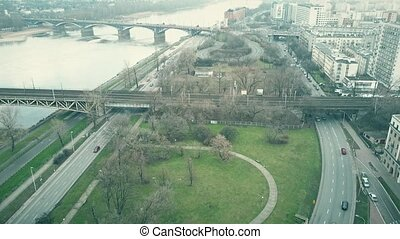 Aerial shot of the Vistula river embankment in Warsaw,...