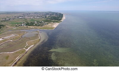 Aerial shot of the wild Black Sea coast with patches of greenary in summer