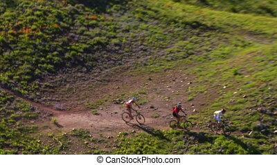 aerial shot of three mountain bikers on Green Mountain
