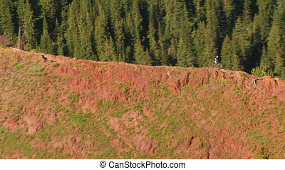 aerial shot of three mountain bikers on red Ridge