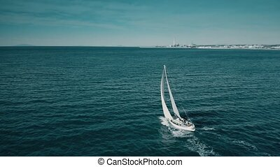 Aerial shot of unknown yacht sailing