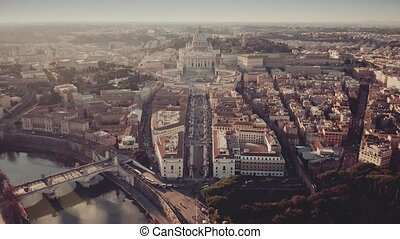 Aerial shot of Vatican City and cityscape of Rome