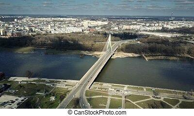 Aerial shot of Vistula river and cable bridge in Warsaw, Poland. 4K clip