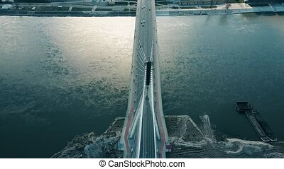 Aerial shot of Vistula river and Holy Cross cable bridge in Warsaw, Poland.