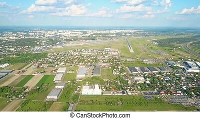 Aerial shot of Warsaw international airport and commercial...