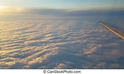 Aerial shot of white and violet clouds seen from a plane...