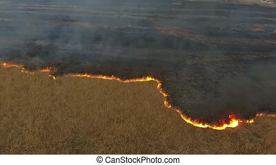 Aerial shot of wild firewall advancing at Dnipro basin...