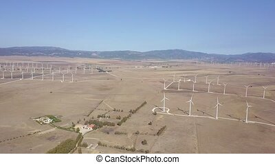 Aerial shot of windmills in desert - Shot taken with drone...