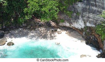 Aerial shot of Woman at Tembeling Beach Nusa Penida, Bali....