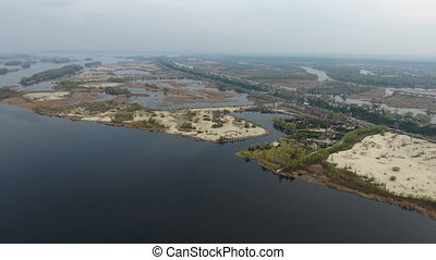 Aerial shot on the Dnipro river basin with numerous sandy islets in a sunny day
