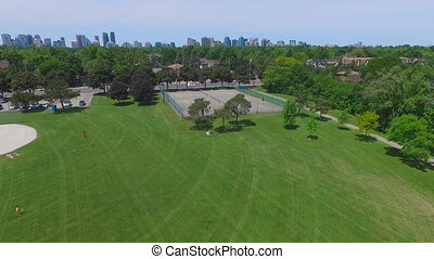 Aerial shot over tennis court in the park
