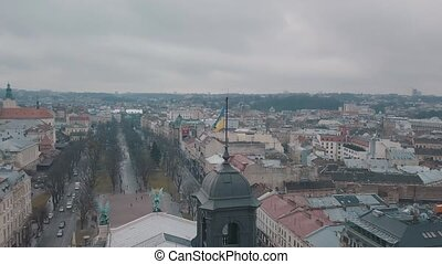 Aerial Shot Ukrainian Flag Flying on Top of Lviv Opera. European City.