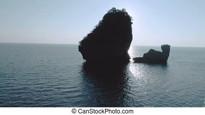 Aerial shot video of Camel Rock in Nui Bay at Phi Phi Don during sunset