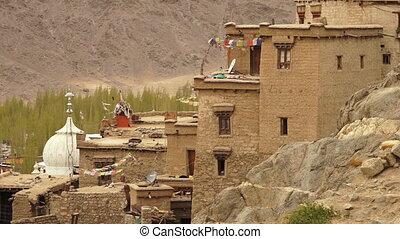 Aerial side view of Leh Palace, Ladakh - High angle, medium...