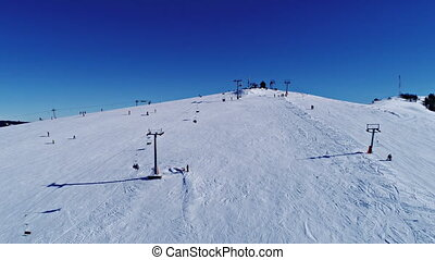 Aerial - Ski lift at ski resort in sunny Carpatian mountains...