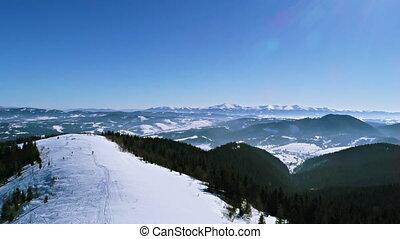 Winter in Carpatian mountains, ski resort landscape with a bird's eye view, UHD 4K