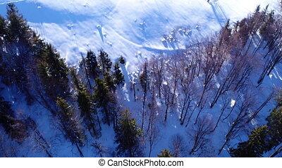 Aerial - Ski lift at ski resort in sunny Carpatian mountains...