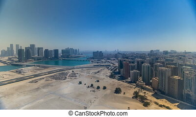 Aerial skyline of Abu Dhabi city centre from above during...