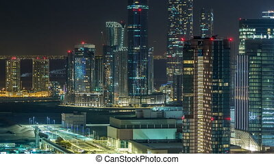 Aerial skyline of Abu Dhabi city centre from above night...